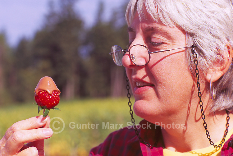 Woman eating Chocolate Dipped Strawberry at the Cowichan Valley Wine & Culinary Festival, Vancouver Island, BC, British Columbia, Canada (Model Released)