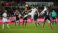 Ashley Williams of Swansea (C) scores with a header during the Barclays Premier League match between Swansea City and Watford at the Liberty Stadium, Swansea on January 18 2016