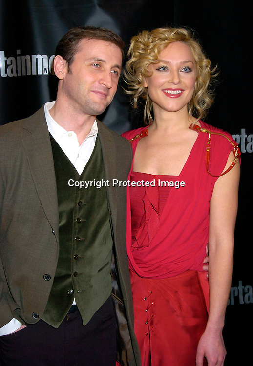 Elisabeth Rohm and Dan Abrams..at the Entertainment Weekly 10th annual Oscar Party on ..February 29, 2004 at Elaine's in New YOrk City. Photo by Robin Platzer, Twin Images