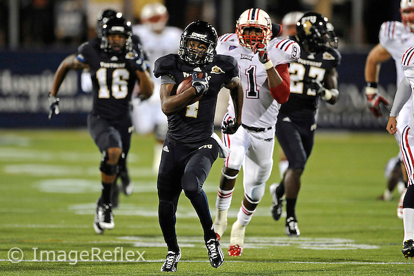 12 November 2011:  FIU wide receiver T.Y. Hilton (4) takes a punt return 97 yards for a touchdown in the second quarter as the FIU Golden Panthers defeated the Florida Atlantic University Owls, 41-7, to win the annual Shula Bowl game, at FIU Stadium in Miami, Florida.