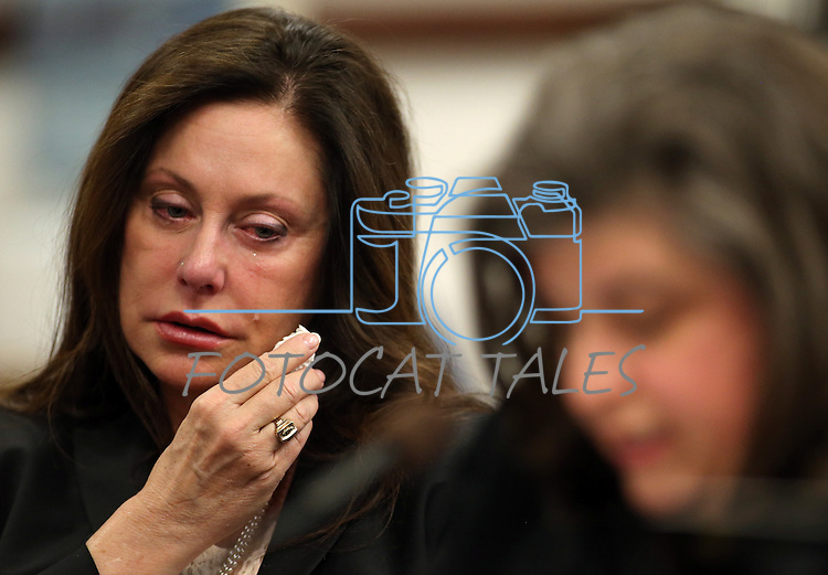 Bridgette Denison wipes away tears as her sister-in-law Lauren Denison testifies in a Senate Judiciary hearing at the Legislative Building in Carson City, Nev., on Thursday, March 14, 2013. The family is urging lawmakers to support a bill that would require anyone arrested for a felony to submit a DNA sample. The bill, commonly known as Brianna's Law, is named after Bridgette Denison's daughter who was murdered in Reno, Nev., in 2008. (AP Photo/Cathleen Allison)