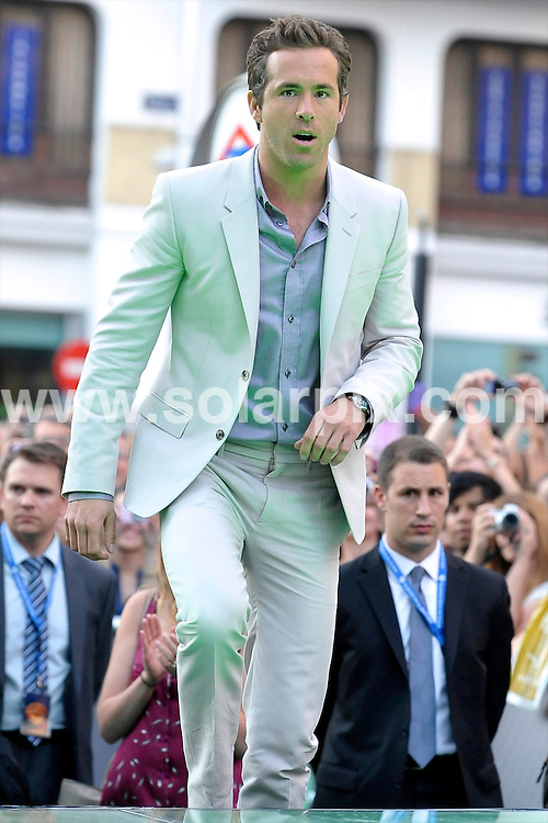 **ALL ROUND PICTURES FROM SOLARPIX.COM**                                             **WORLDWIDE SYNDICATION RIGHTS EXCEPT SPAIN - NO SYNDICATION IN SPAIN**                                                                                  Caption: Green Lantern Premiere, held at the Callao Cinema, Callao Square, Madrid, Spain. 21 July 2011                                                                             This pic: Ryan Reynolds                                              JOB REF: 13754 DMS Jextu     DATE: 21_07_2011                                                           **MUST CREDIT SOLARPIX.COM OR DOUBLE FEE WILL BE CHARGED**                                                                      **MUST AGREE FEE BEFORE ONLINE USAGE**                               **CALL US ON: +34 952 811 768 or LOW RATE FROM UK 0844 617 7637**