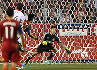 Goalie Nick Rimando (r) of Real Salt Lake watches a ball go by for a goal by Lewis Neal #24 of D.C. United during the first half of the U.S. Open Cup Final on October  1, 2013 at Rio Tinto Stadium in Sandy, Utah.