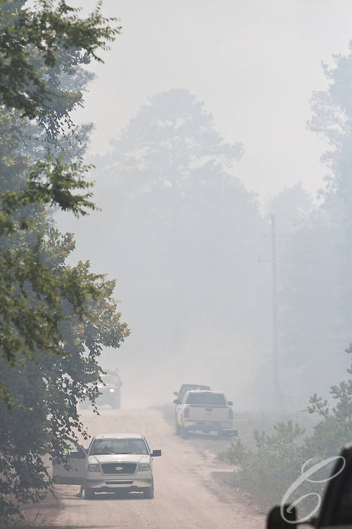 Fire crews found themselves along the aptly named Sparks Lane while fighting the Dyer Mill fire in Grimes County, Texas on June 21, 2011.