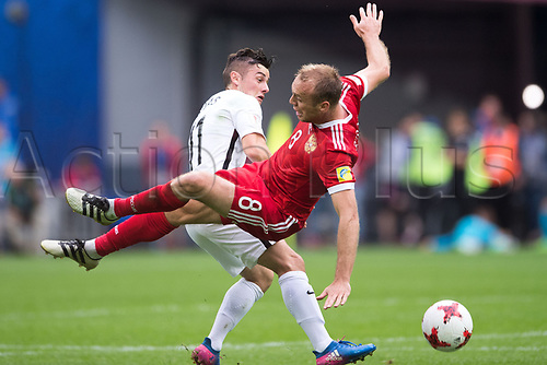 17th June 2017, St Petersburg, Russia; FIFA 2017 Confederations Cup football, Russia versus New Zealand; Group A - Saint Petersburg Stadium,  Russia'S Denis Glushakov trips over New Zealand's Marco Rojas during the Confederations Cup Group A soccer match between Russia and New Zealand at the stadium in Saint Petersburg, Russia, 17 June 2017.