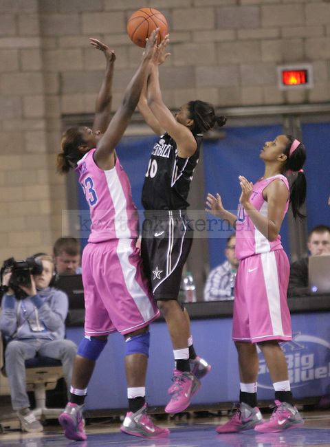 UK forward Samarie Walker attempts to block Vanderbilt's Christina Foggie's shot during the second half of the UK Women's basketball game against Vanderbilt on 2/20/12 at Memorial Coliseum in Lexington, Ky. Photo by Quianna Lige | Staff