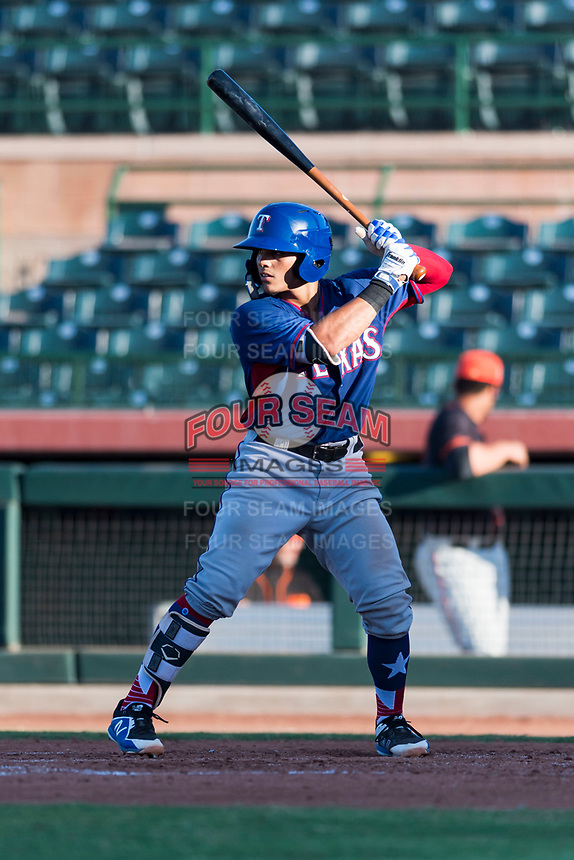 AZL Rangers catcher Xavier Valentin (45) at bat during an Arizona League game against the AZL Giants Black at Scottsdale Stadium on August 4, 2018 in Scottsdale, Arizona. The AZL Giants Black defeated the AZL Rangers by a score of 3-2 in the first game of a doubleheader. (Zachary Lucy/Four Seam Images)
