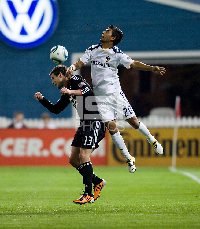 Chris Pontius (13) of D.C. United goes up for a header against A.J. DeLaGarza (20) of the LA Galaxy  during the game at RFK Stadium.  D.C. United tied the LA Galaxy, 1-1.