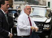 United States Vice President-elect Mike Pence is seen arriving at the East 56th Street entrance of Trump Tower in New York, NY, USA on December 15, 2016. <br /> Credit: Albin Lohr-Jones / Pool via CNP
