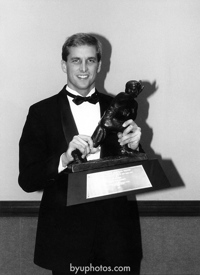 Detmer w/trophy.tif<br /> <br /> Ty Detmer with Heisman Trophy<br /> <br /> Photo by: Mark Philbrick/BYU<br /> <br /> Copyright BYU PHOTO 2008<br /> All Rights Reserved<br /> 801-422-7322<br /> photo@byu.edu