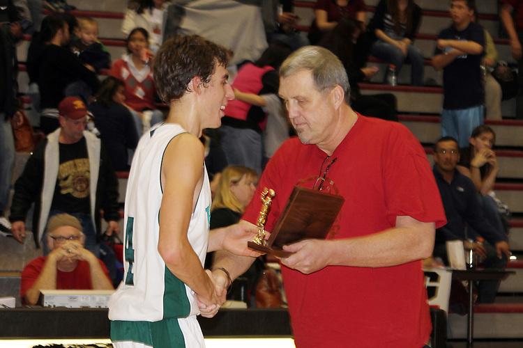 Photograph from the 2010-11 Mt. Rainier Lutheran High School boy's basketball Tri-District playoff run.