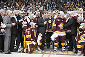 Luke McManus (Duluth - 21), Derek Plante (Duluth - Assistant Coach), Cody Danberg (Duluth - 20), Bill Watson (Duluth - Volunteer Assistant Coach), Kyle Schmidt (Duluth - 7), Kenny Reiter (Duluth - 35), ?, Clay Matvick, Mike Connolly (Duluth - 22), Justin Faulk (Duluth - 25), Joe Basaraba (Duluth - 18), Scott Sandelin (Duluth - Head Coach), Jack Connolly (Duluth - 12), ?, Brett Larson (Duluth - Assistant Coach), Dan DeLisle (Duluth - 10), ?, Keegan Flaherty (Duluth - 14) - The University of Minnesota-Duluth Bulldogs celebrated their 2011 D1 National Championship win on Saturday, April 9, 2011, at the Xcel Energy Center in St. Paul, Minnesota.