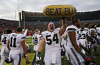 "Ohio State Buckeyes offensive lineman Billy Price (54) hoists the marching band's ""beat blue"" banana following the NCAA football game against the Michigan Wolverines at Michigan Stadium in Ann Arbor on Nov. 25, 2017. Ohio State won 31-0. [Adam Cairns/Dispatch]"