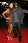 """HOLLYWOOD, CA. - December 03: Actress Eva Marcille and Actor Lance Gross arrive at the Los Angeles premiere of """"Nothing Like The Holidays"""" at Grauman's Chinese Theater on December 3, 2008 in Hollywood, California."""