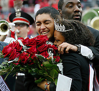 Amit Raghuvanshi and Chasmine Anderson were named the 2014 Homecoming King and Queen before Saturday's NCAA Division I football game between the Ohio State Buckeyes and the Rutgers Scarlet Knights at Ohio Stadium in Columbus on Saturday, Oct. 18, 2014. (Dispatch Photo by Barbara J. Perenic)