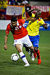 Ecuador's player Cristian Benitez ( R) fights for the ball against Chile's player Carlos Labrin during their friendly match at the Citi-Field Stadium in New York, August 15, 2012. Photo by Eduardo Munoz Alvarez / VIEW.