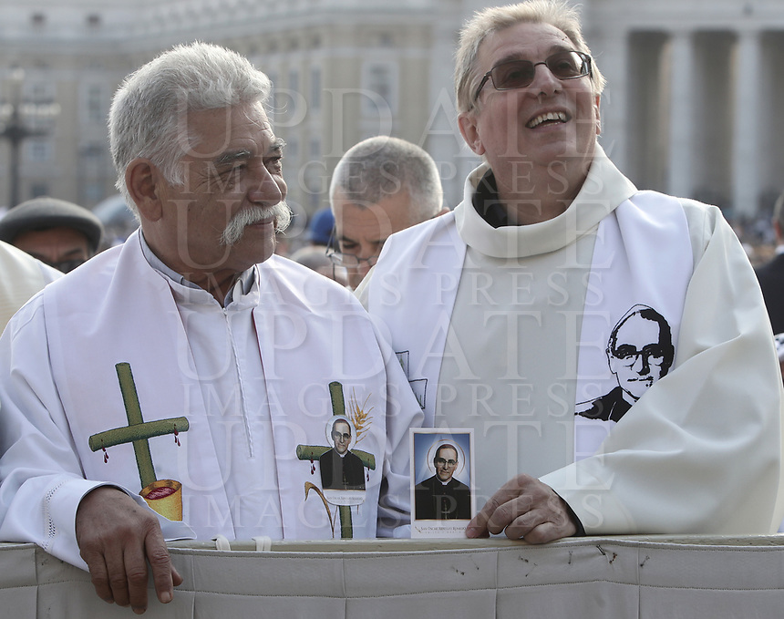 Priests hold a picture of El Salvador Archbishop Oscar Romero before a mass for his canonization in St. Peter's Square at the Vatican, on October 14, 2018.<br /> UPDATE IMAGES PRESS/Isabella Bonotto<br /> <br /> STRICTLY ONLY FOR EDITORIAL USE