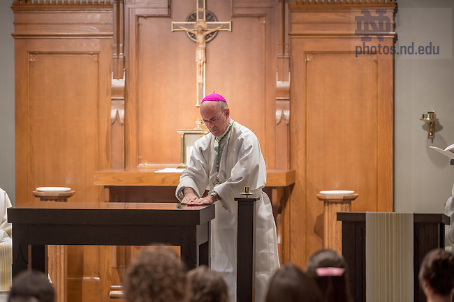 Sept. 7, 2015; Bishop Kevin Rhoades spreads holy chrism on the new altar during the Mass of Dedication in the renovated St. Francis of Assisi Chapel in Breen-Phillips Hall. (Photo by Matt Cashore/University of Notre Dame)