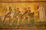 Mosaics in the Basilica of Sant'Apollinare Nuovo in Ravenna, Italy depicting the Three Magi who are moving towards the Madonna and Child.