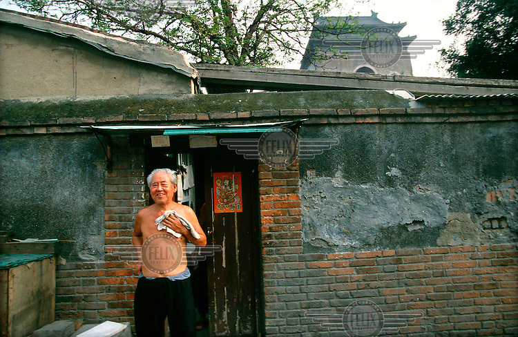 Mark Henley/Panos Pictures..China, Beijing.Old hutong housing close to the Bell Tower, in one of fes remaining old quarters of the city.