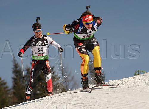 09.12.2011, Hochfilzen, Austria. The IBU Biathlon men's 10km Sprint Graf Florian ger behind LeGuellec Jean Philippe CAN Biathlon World Cup