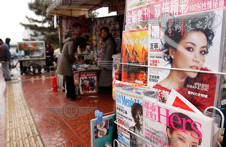 A news stand selling Chinese language versions of Elle, Hers and Men's Health demonstrates the popularity of Chinese editions of foreign magazine publications.Photo: Dermot Tatlow/Panos Pictures/Felix Features