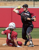 NWA Democrat-Gazette/BEN GOFF @NWABENGOFF<br /> Mackenzie Boesel, South Carolina second baseman, throws to first for a double play to end the 1st inning as Taylor Greene, Arkansas catcher, slides in at second Sunday, March 17, 2019, at Bogle Park in Fayetteville.