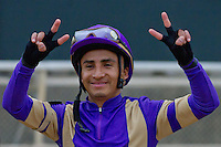 "Rafael Bejarano shows his trademark smile and duces to the crowd after winning the Apple Blossom Stakes with Bob Baffert's ""Plum Pretty"""