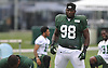 Jarvis Jenkins #98 of the New York Jets stretches at the start of a day of team training camp at Atlantic Health Jets Training Center in Florham Park, NJ on Wednesday, Aug. 3, 2016.