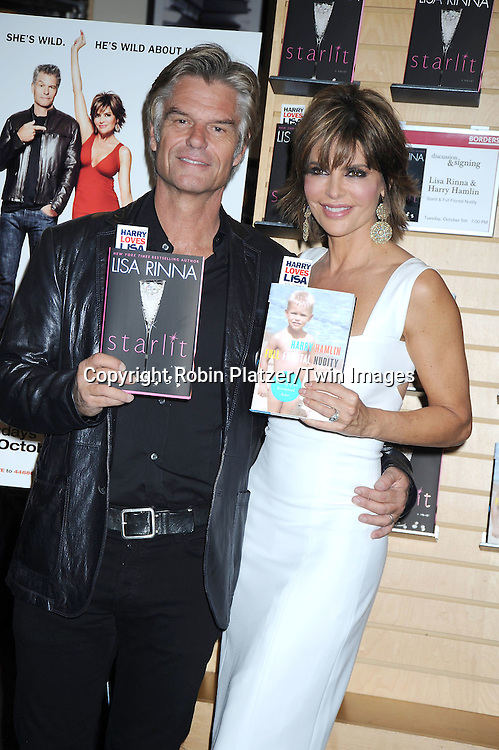 """Harry Hamlin and wife Lisa Rinna signing their new books """"Full Frontal Nudity"""" by Harry and """"Starlit"""" by Lisa Rinna on Oct 5, 2010 at Borders Books at Time Warner Center in New York City. They have a new TV Land Show starting Oct 6, 2010 called """"Harry Loves Lisa"""".Robin Platzer/ Twin Images"""