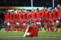 Pictured: Wales rugby players stand during a minute's silence in tribute to the tragic death of cricket player Phillip Hughes. Saturday 29 November 2014<br />