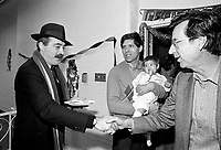 December 19, 1987 File Photo - Montreal, Quebec, CANADA -  Robert Bourassa, Quebec Premier attend Sun Youth fundraiser pasta supper.<br /> In photo : Nick Auf Der Maur (L), Jacques Chagnon and his baby (M) and  Robert Bourassa, (R)
