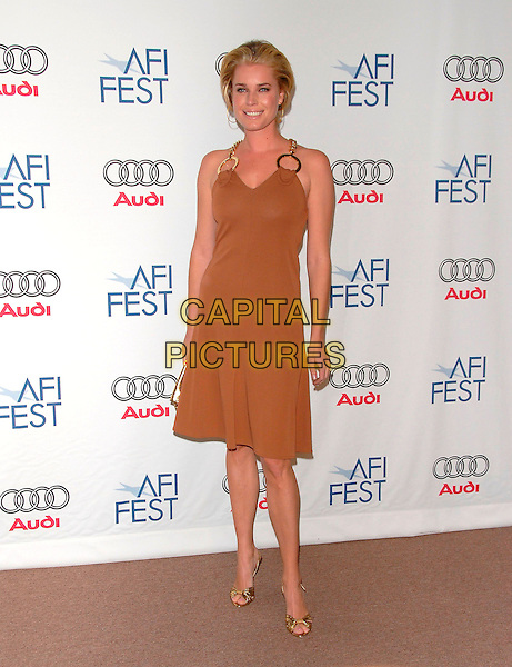 REBECCA ROMIJN.attends AFI Film Festival Screening of Lies & Alibis held at the Arclight Rooftop in Hollywood, California, USA, November 10th 2006.full length gold discs circles chain halterneck dress strap brown beige clutch bag shoes.Ref: DVS.www.capitalpictures.com.sales@capitalpictures.com.©Debbie VanStory/Capital Pictures