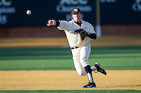 Wake Forest Demon Deacons shortstop Conor Keniry (14) makes a throw to first base against the Towson Tigers at Wake Forest Baseball Park on February 15, 2014 in Winston-Salem, North Carolina.  (Brian Westerholt/Four Seam Images)