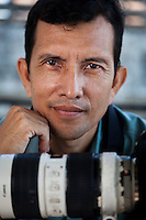 July 20, 2010 - Phnom Penh, Cambodia. Photographer and artist Mak Remissa in his home. © Nicolas Axelrod / Ruom