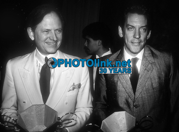 Tom Wolfe and Donald Sutherland 1983<br /> Photo By John Barrett/PHOTOlink