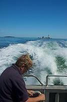 M/V Columbia Point Crew Member Departing Boston Light