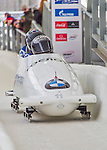 9 January 2016: Russian pilot Nikita Kakharov leads his 4-man team as they cross the finish line after their second run of the day at the BMW IBSF World Cup Bobsled Championships at the Olympic Sports Track in Lake Placid, New York, USA. Kakharov's team came in 10th for the day, with a 2-run combined time of 1:50.97. Mandatory Credit: Ed Wolfstein Photo *** RAW (NEF) Image File Available ***