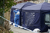 Pictured: Police and forensics officers at the house in Aberaeron, where the remains of a woman have been discovered in Ceredigion County, Wales, UK. Wednesday 21 March 2018<br /> Re: Human remains have been found in a house following a police investigation to find a missing woman.<br /> Police were called to the property in Aberaeron, west Wales after a woman in her 50s collapsed.<br /> Police also discovered the woman's mother, in her 80s, who had not been seen for some time.<br /> The women were named locally as Gaynor and Valerie Jones, with police currently treating the death as unexplained.<br /> The two women have ben described as &quot;reclusive&quot; by neighbours and the home they shared as being &quot;heavily cluttered&quot;.