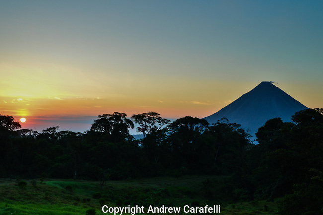 Still smoking after its last eruption, Arenal Volcano in Costa Rica greets the morning sun.