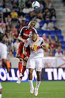 Ty Harden (20) of Toronto FC and Thierry Henry (14) of the New York Red Bulls go up for a header. The New York Red Bulls defeated Toronto FC 5-0 during a Major League Soccer (MLS) match at Red Bull Arena in Harrison, NJ, on July 06, 2011.