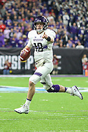Indianapolis, IN - December 1, 2018: Northwestern Wildcats quarterback Clayton Thorson (18) direct his teammate during the Big Ten championship game between Northwestern  and Ohio State at Lucas Oil Stadium in Indianapolis, IN.   (Photo by Elliott Brown/Media Images International)