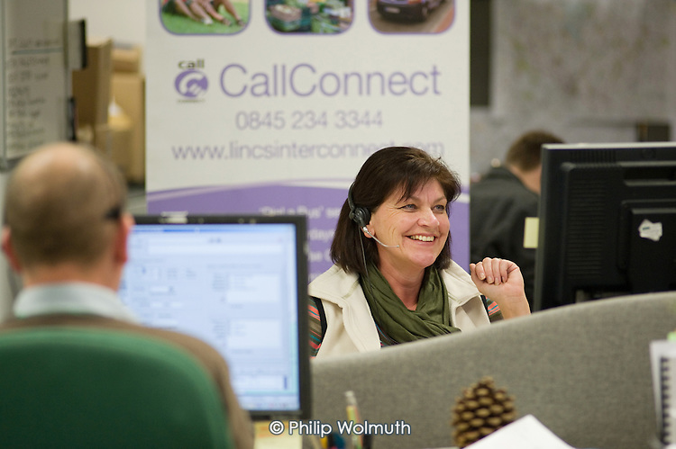 "A journey book agent at the CallConnect transport hub, Lincoln.  The innovative bus-on-demand service features in the Rural Media Company's ""Over the Hill?"" project."