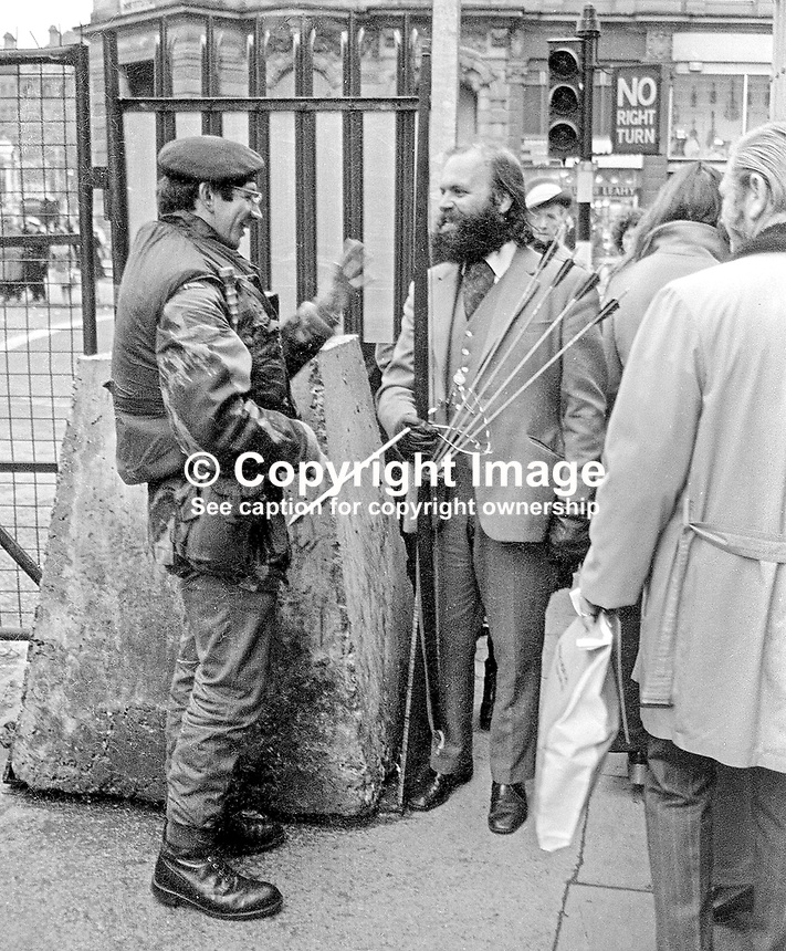 Lindsay Mason, an independent loyalist member of Belfast City Council, attempts to gain access to the city&rsquo;s main shopping area carrying a longbow and arrows. He was detained by the military for a short time and released. He took to carrying a bow and arrows when the police withdrew his firearm&rsquo;s licence. Due to his eccentricities and the fact that he wasn't tied to any major party be received wide media coverage. 197212140783a<br />