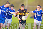 Kyle Fitzgibbon Austin Stacks is tackled by Jack O'Connor left and Liam Quirke Laune Rangers