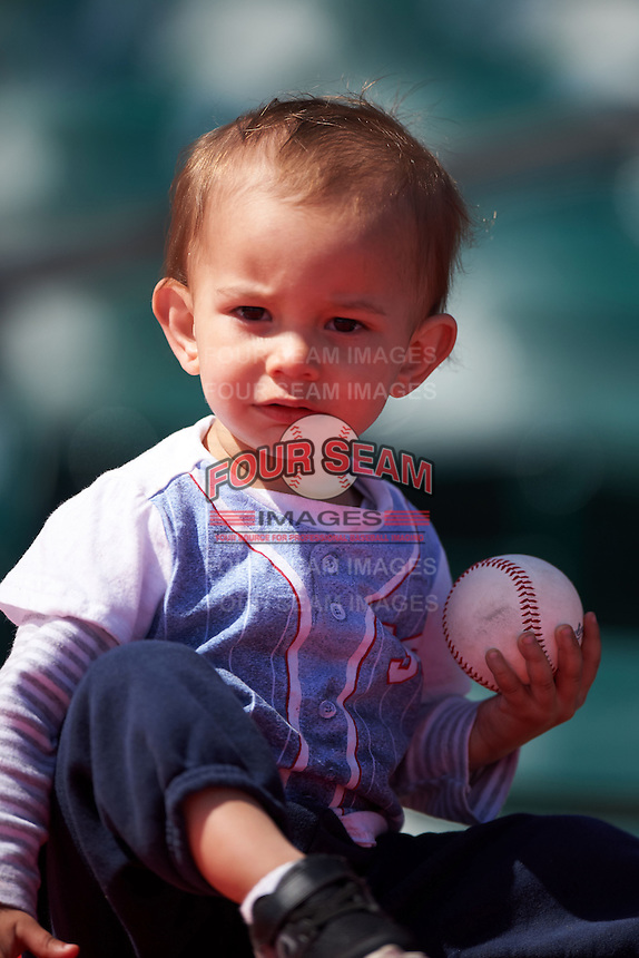 Buffalo Bisons young fan holding a game ball during a game against the Louisville Bats on May 2, 2015 at Coca-Cola Field in Buffalo, New York.  Louisville defeated Buffalo 5-2.  (Mike Janes/Four Seam Images)