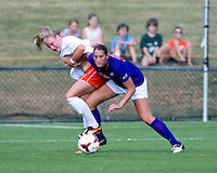 Makenzy Doniak (9) of Virginia fights for the ball with Jenna Weston (20) of Clemson at Klockner Stadium in Charlottesville, VA.  Virginia defeated Clemson, 3-0.