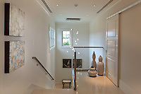 Floated glass spheres light fixture at the stair landing dance in the air and complement the glass and stainless railing