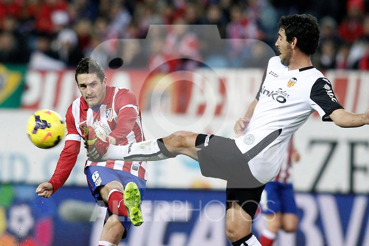 Atletico de Madrid's Koke (l) and Valencia's Daniel Parejo during La Liga match.December 15,2013. (ALTERPHOTOS/Acero)