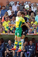 Marco Stiepermann of Norwich City and George Friend of Middlesbrough both go for the aerial ball during Norwich City vs Middlesbrough, Sky Bet EFL Championship Football at Carrow Road on 15th September 2018